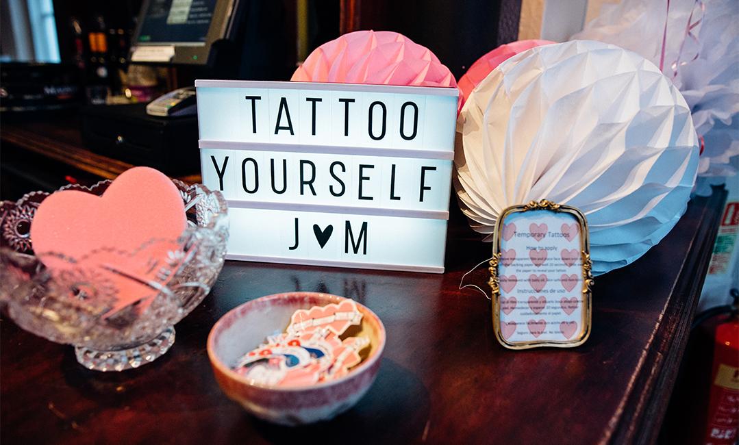 london pub wedding - temporary tattoo bar