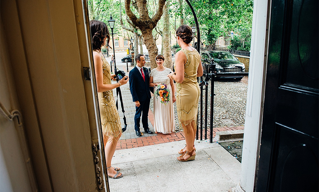 pub wedding photography bride brother and bridesmaids stand outside camberwell registry office