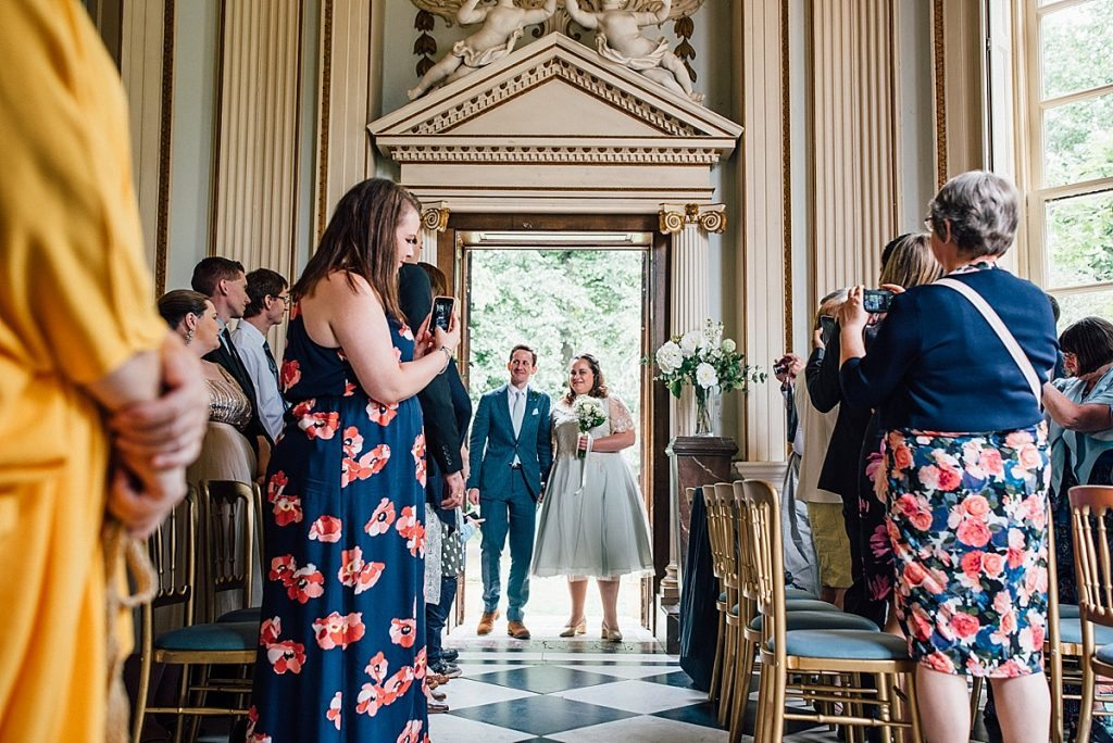 bride and groom enter ceremony taken by Parrot & Pineapple Wedding Photography