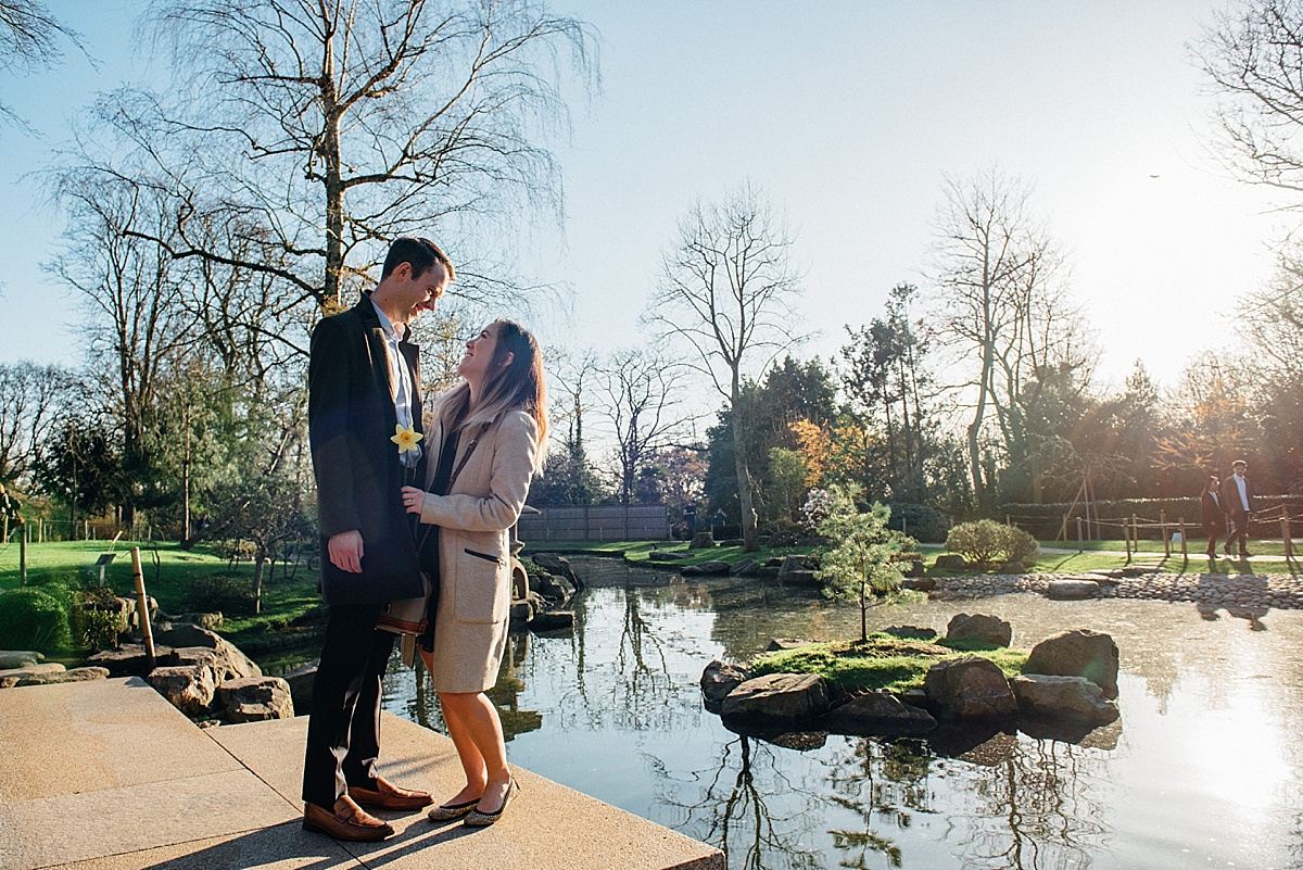 proposal photography couple stand on bridge in kyoto garden holland park