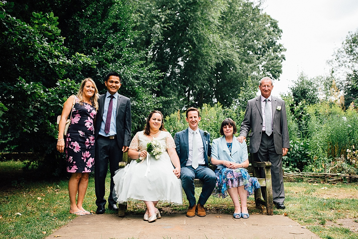 fun wedding photography group wedding photo in garden
