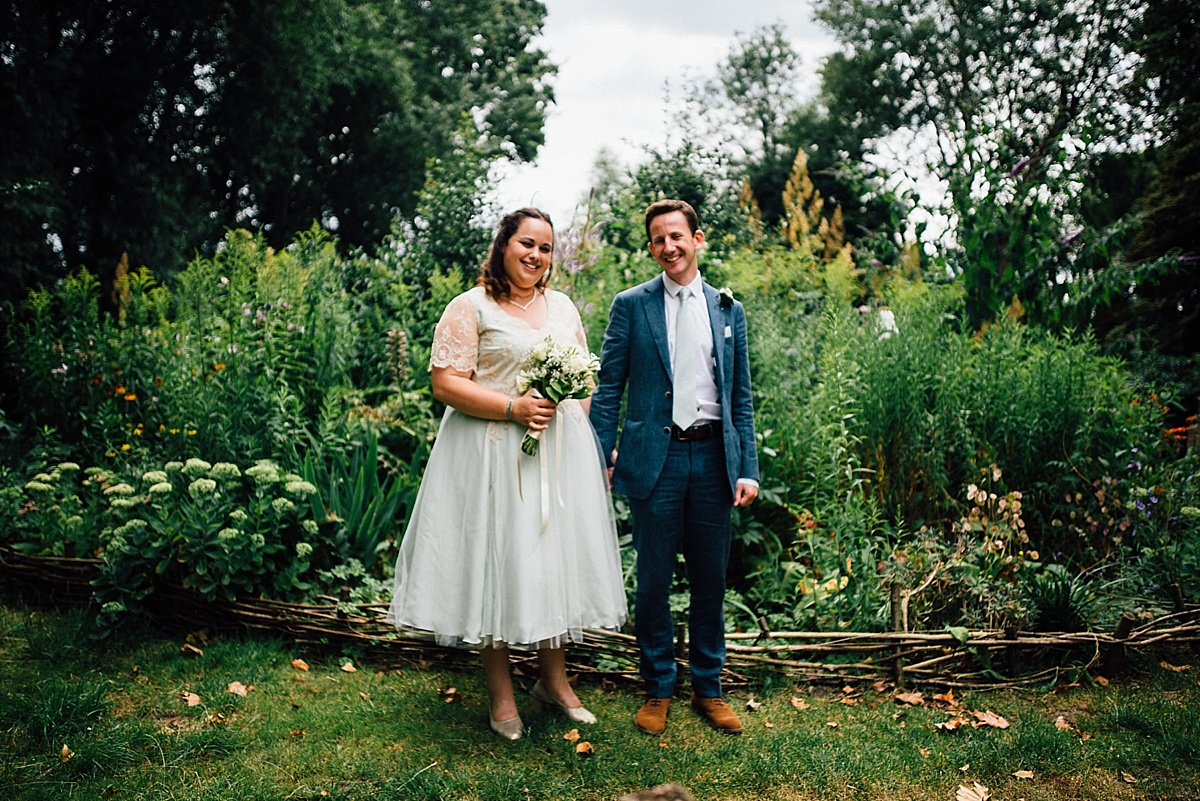 fun wedding photography informal portrait of bride and groom in garden