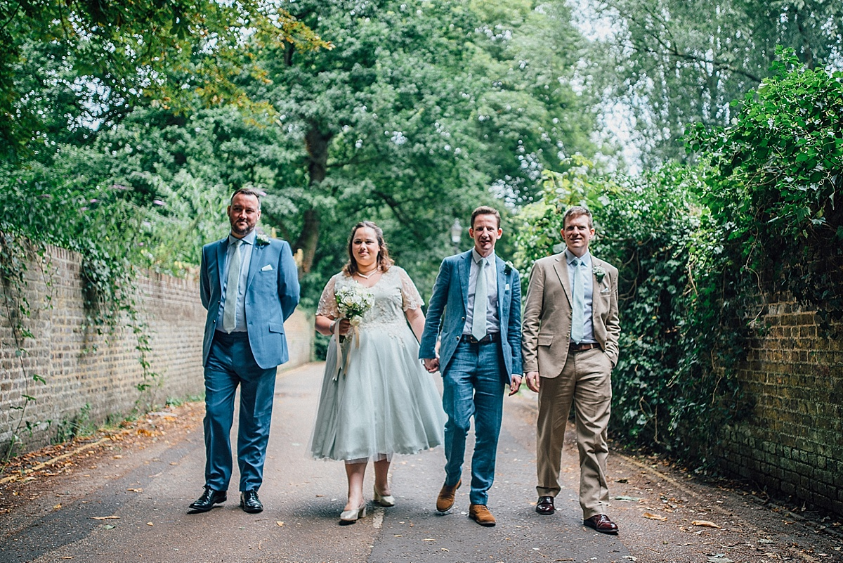 fun wedding photography bridal party to walk to secret river garden wedding
