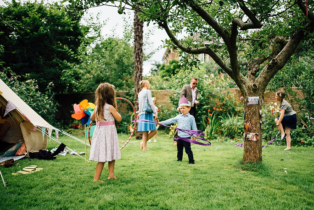 fun wedding photography children play at garden wedding