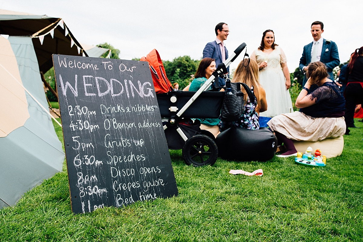 fun wedding photography chalk board running order wedding sign