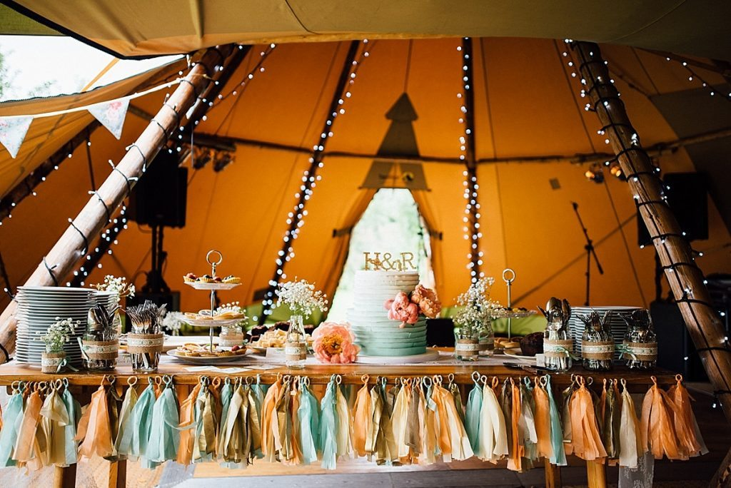 DIY decorated cake table in wedding tipi taken by Parrot & Pineapple Wedding Photography