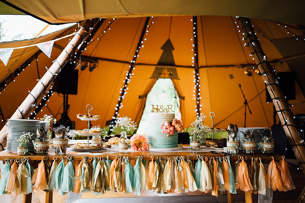 fun wedding photography DIY decorated cake table in wedding tipi