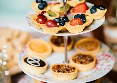 bite sized cakes on tiered cake stand taken by Parrot & Pineapple Wedding Photography