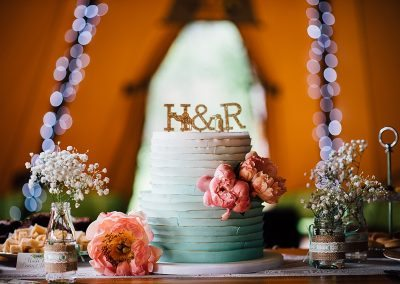ombre wedding cake with gold cake topper taken by Parrot & Pineapple Wedding Photography