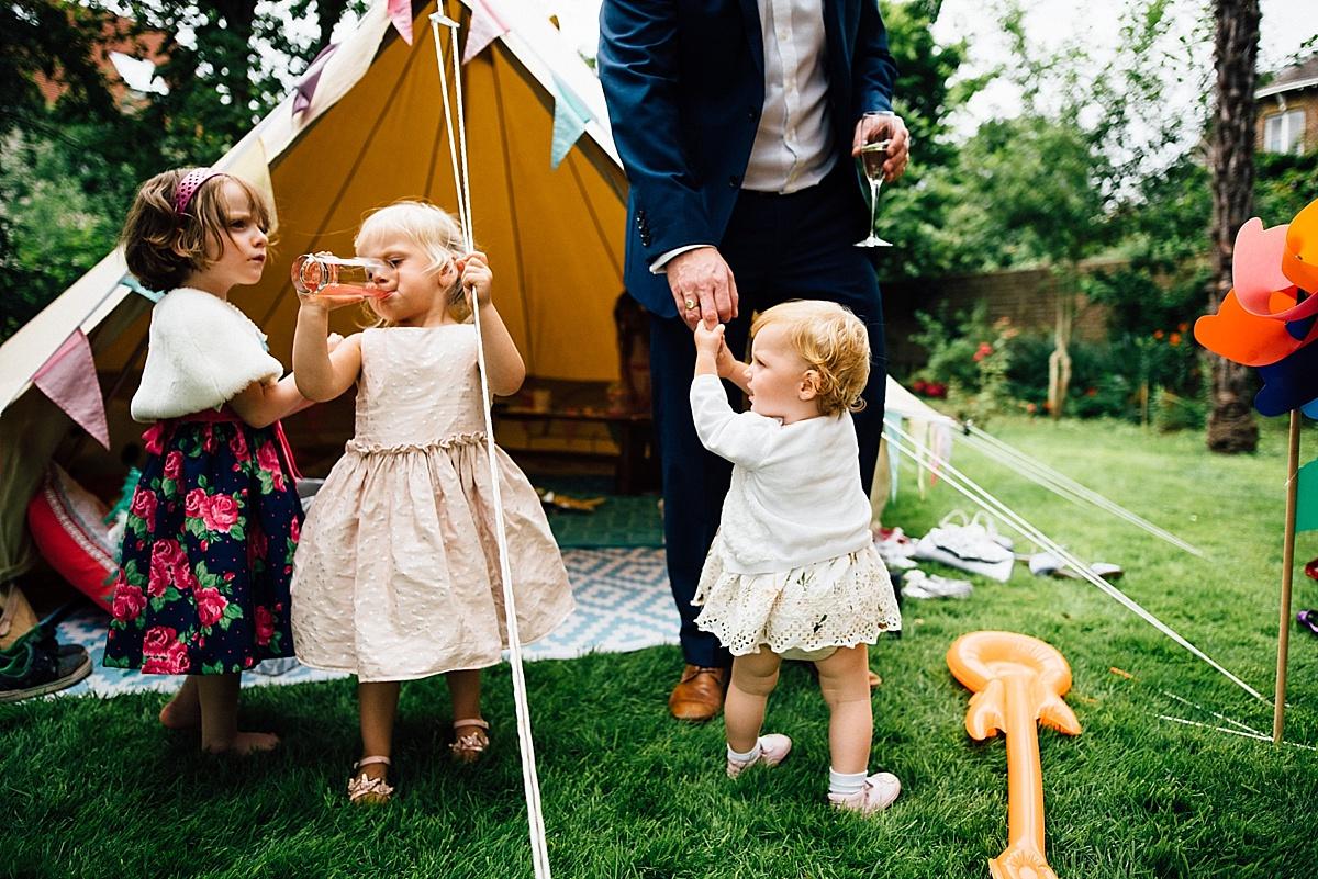 fun wedding photography children play at garden wedding