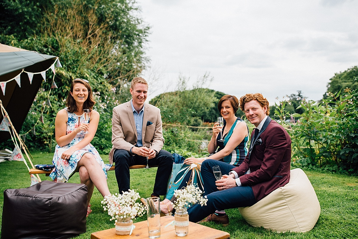 fun wedding photography guests relax at garden wedding