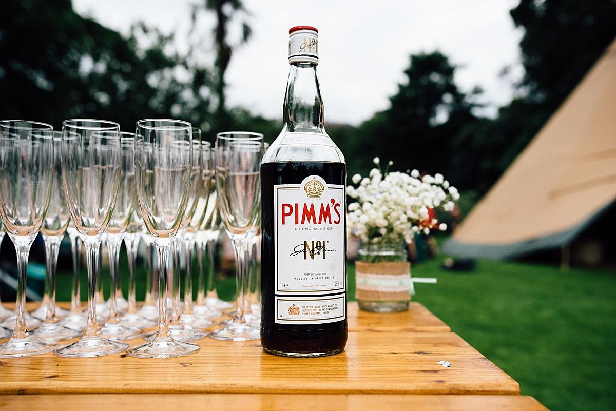 fun wedding photography bottle of pimms at london garden wedding