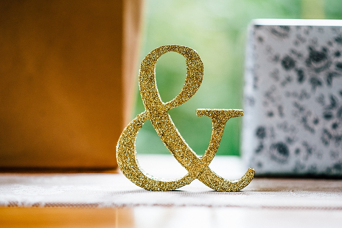 fun wedding photography gold glitter ampersand gift table decoration