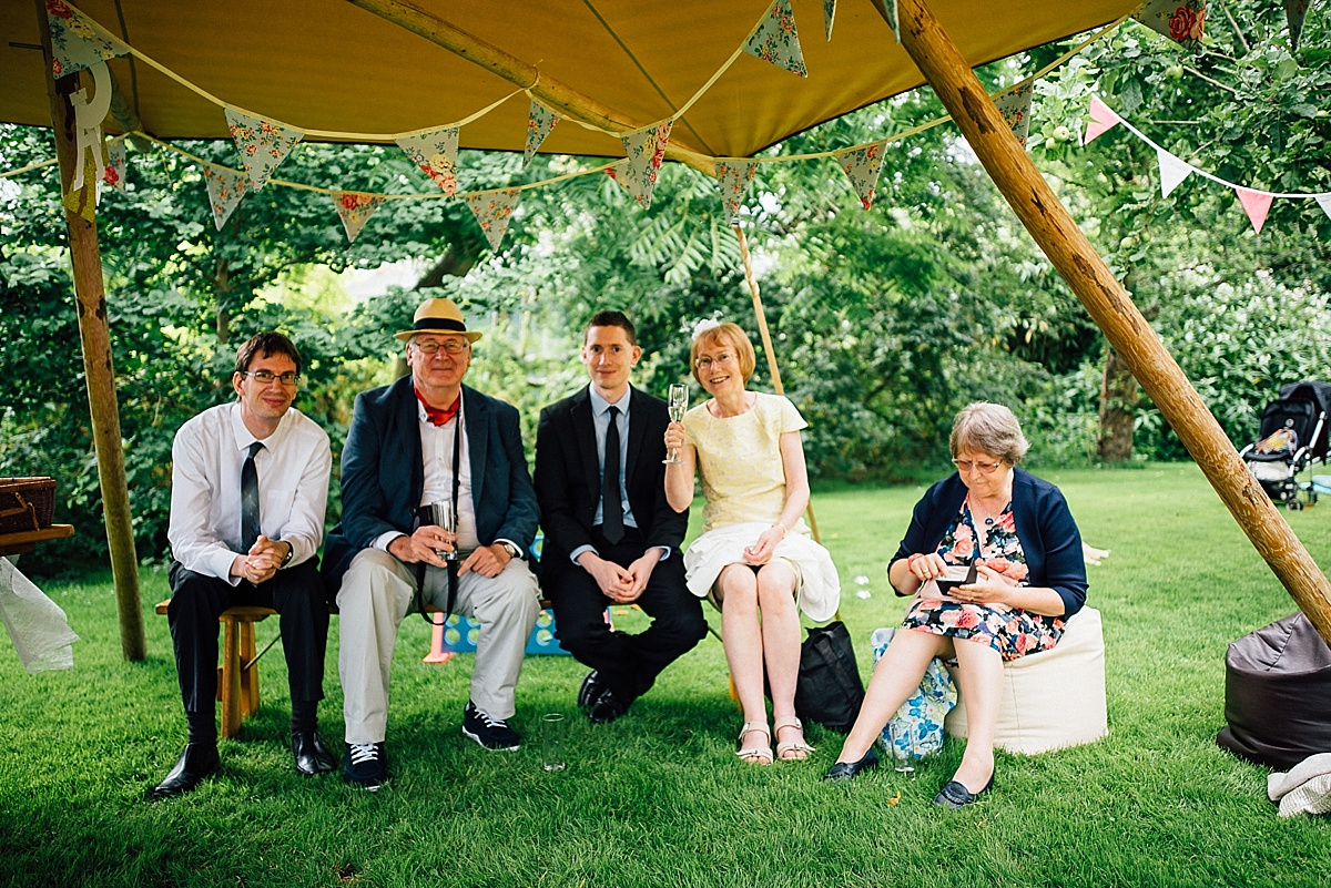 fun wedding photography guests relax at informal garden wedding