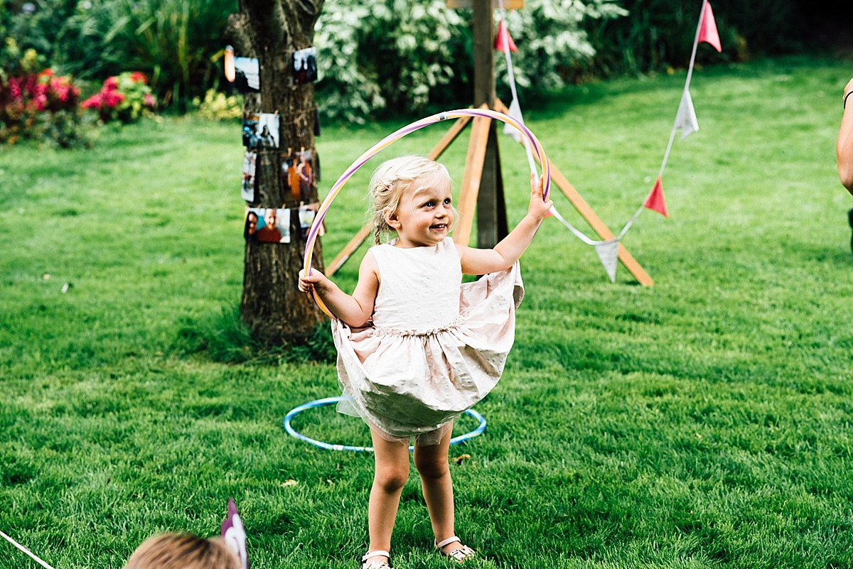 fun wedding photography little girl plays with hula hoop from the little top