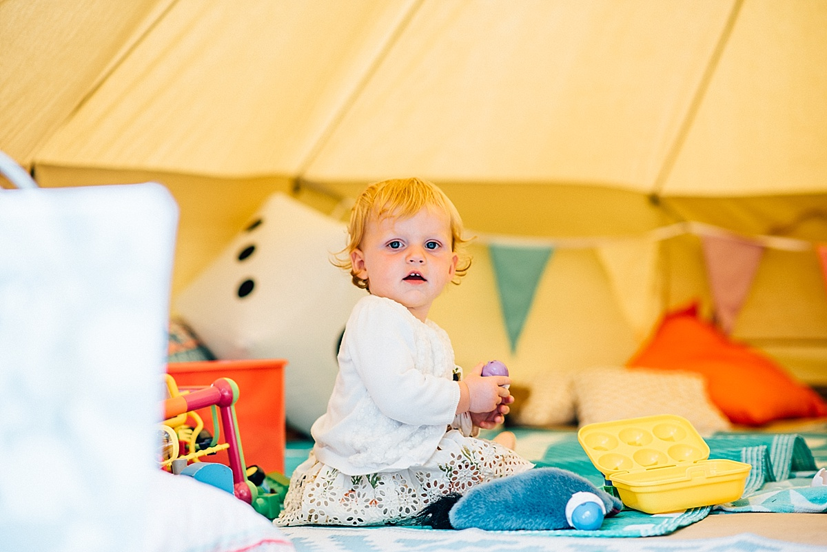 fun wedding photography little girl plays inside tipi from the little top