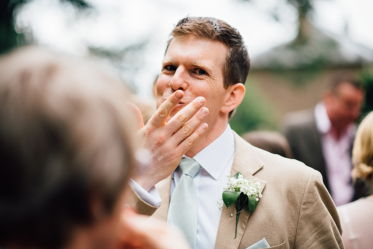 fun wedding photography best man caught eating