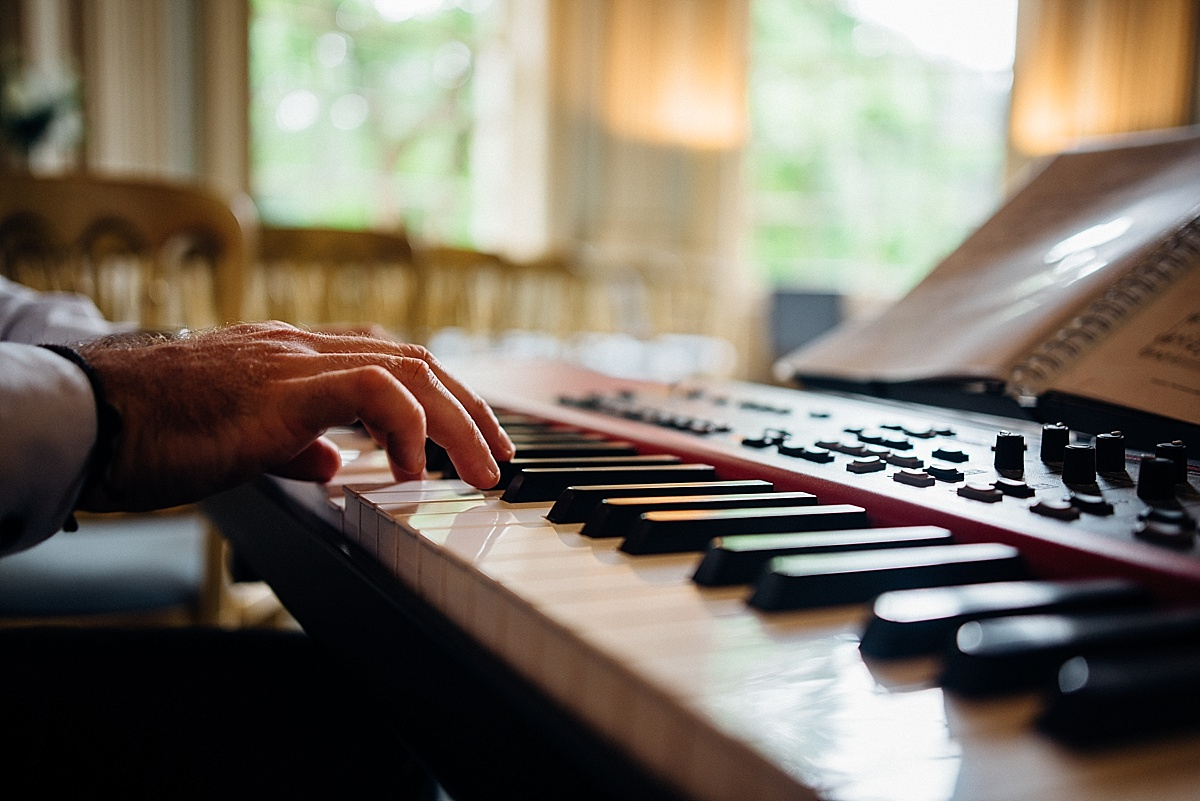 fun wedding photography fingers on piano keys