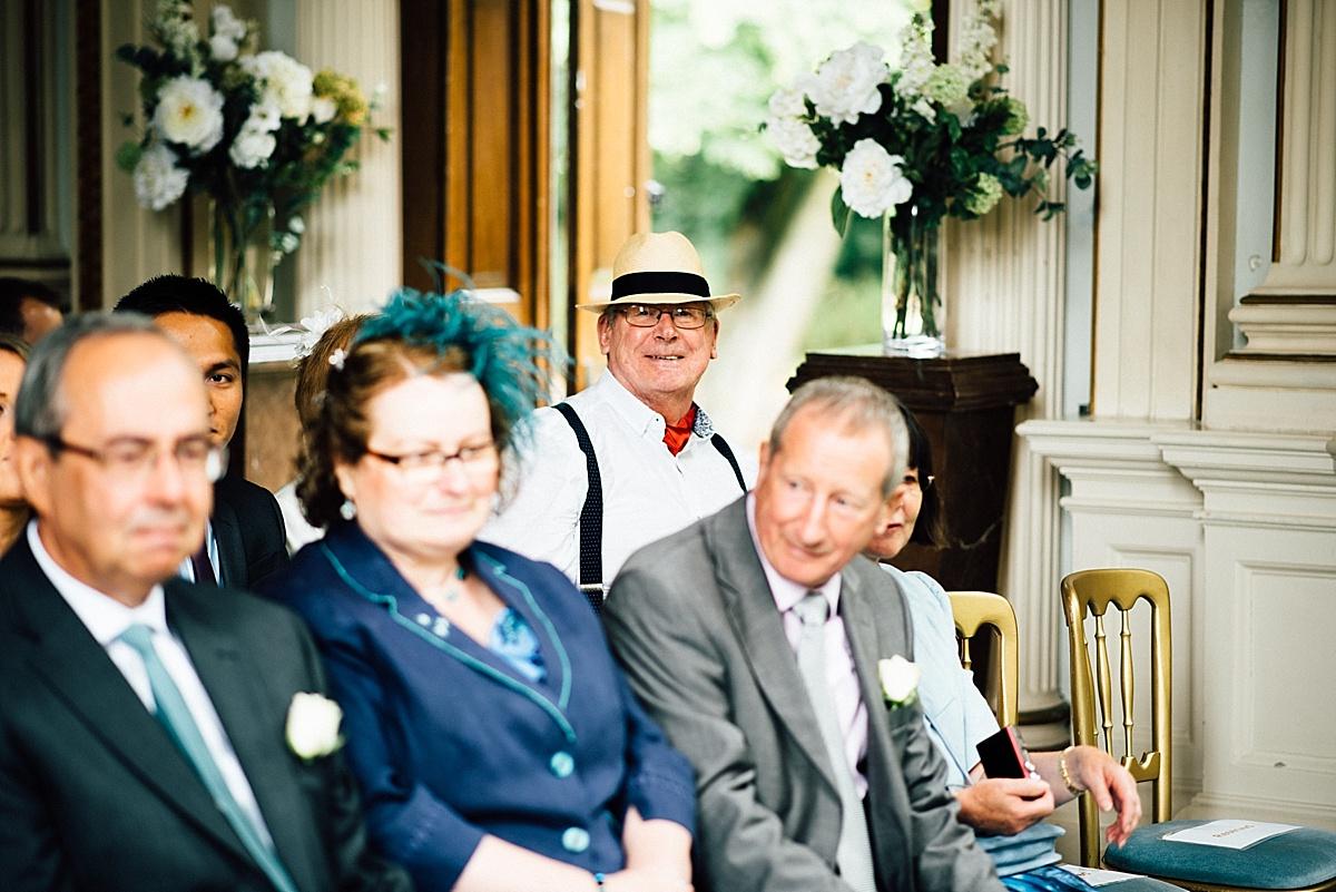 fun wedding photography wedding guest in straw hat