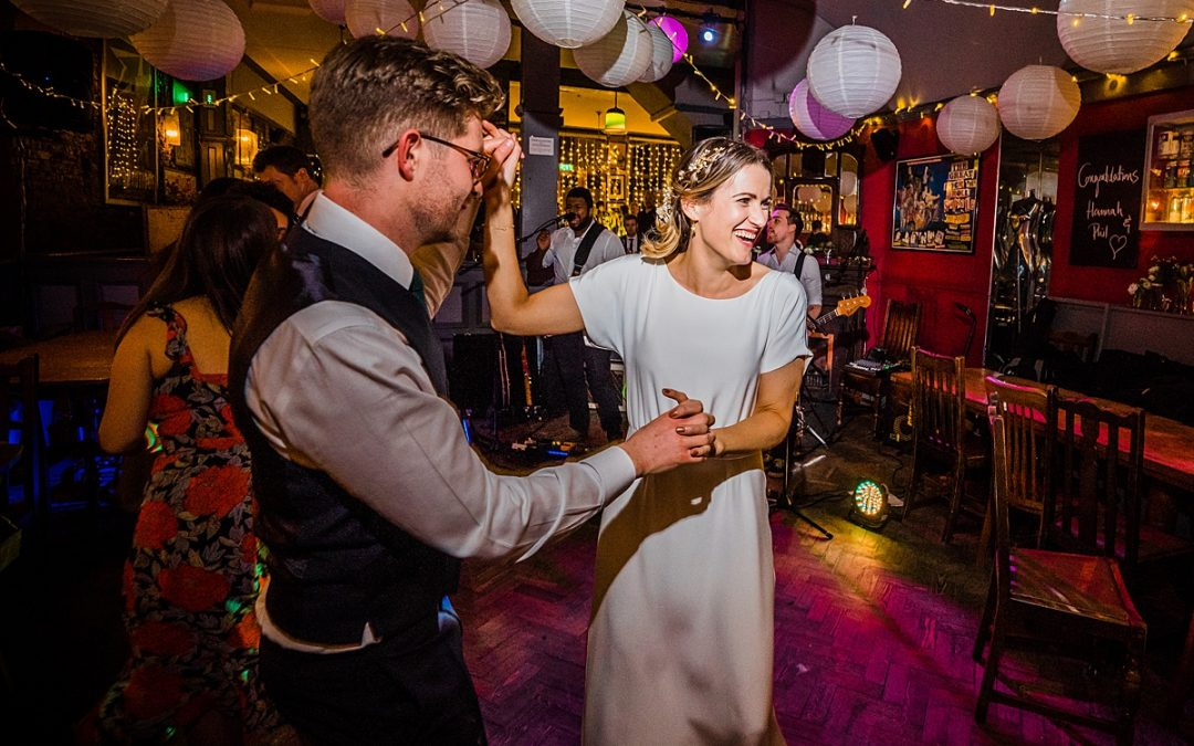 bride and groom dance together at fun wedding party at the londesborough in east london