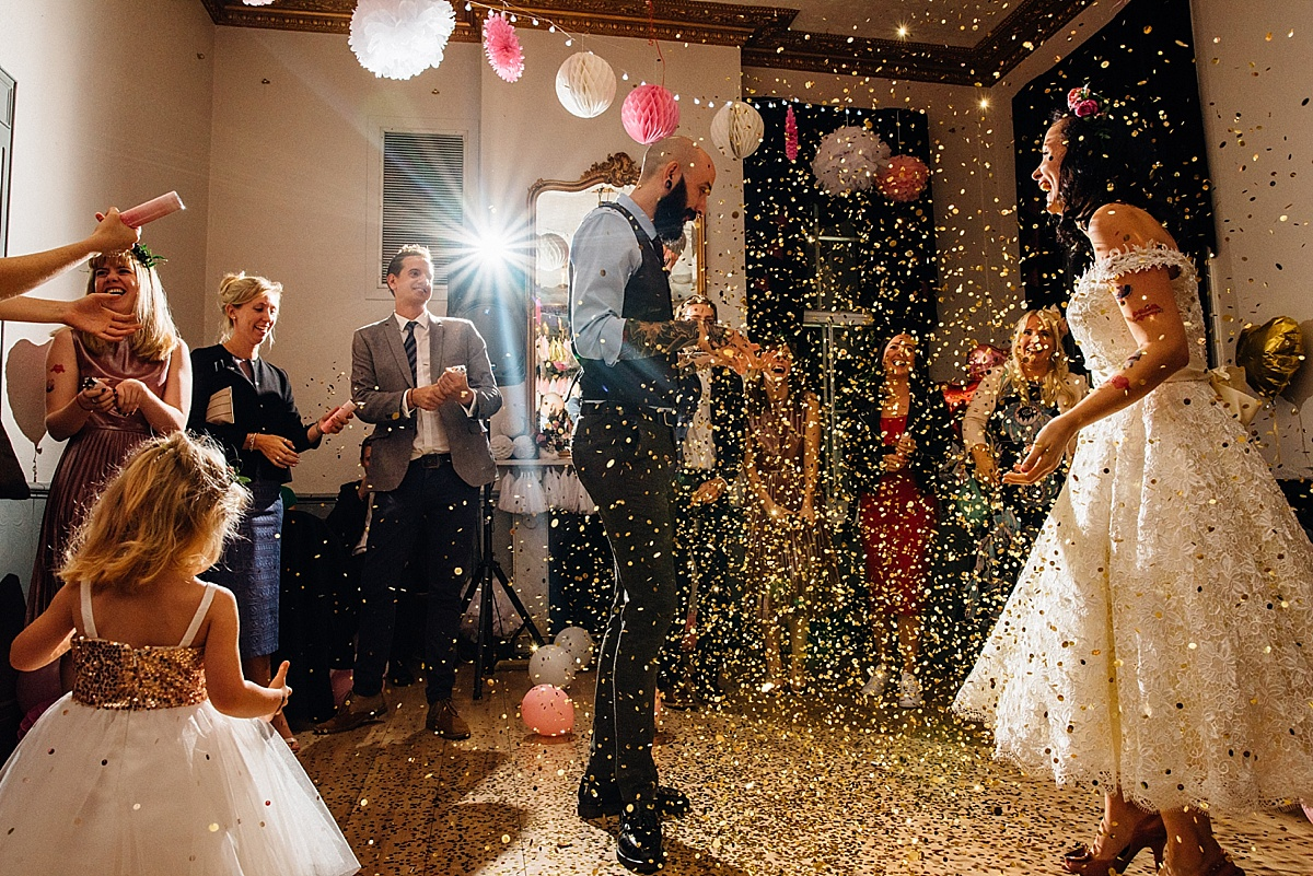 relaxed wedding photography gold confetti shower wedding party