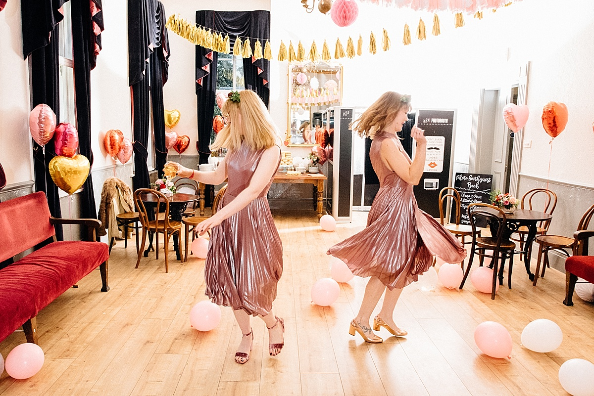 relaxed wedding photography pink metallic bridesmaids twirling