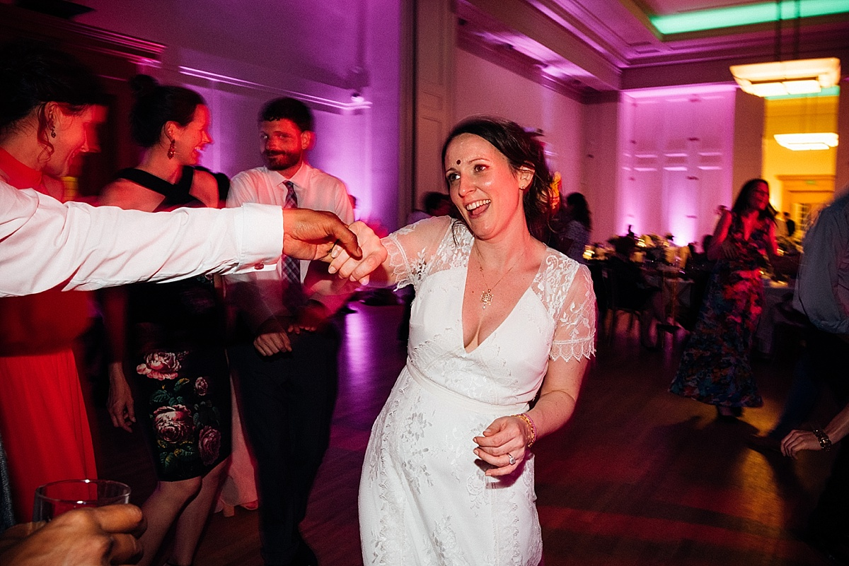 fun wedding party bride laughing dancing wedding party