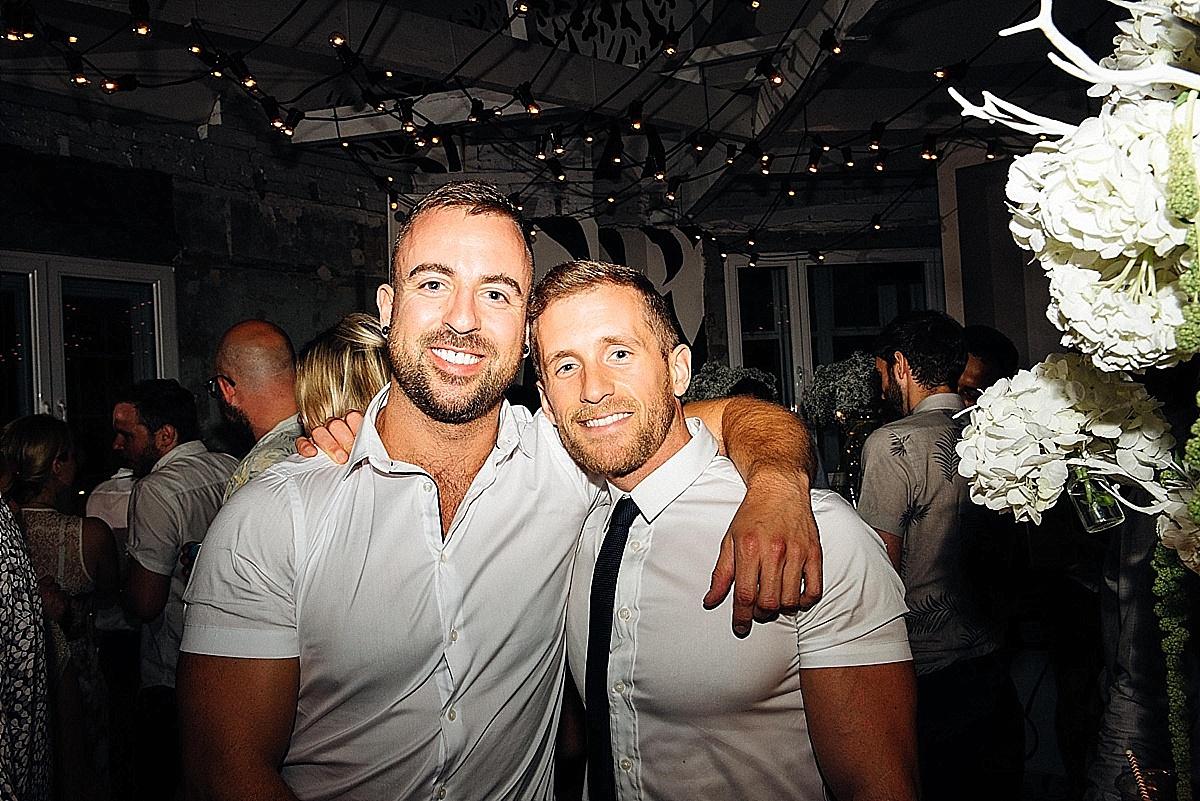 fun wedding party gay couple wedding party