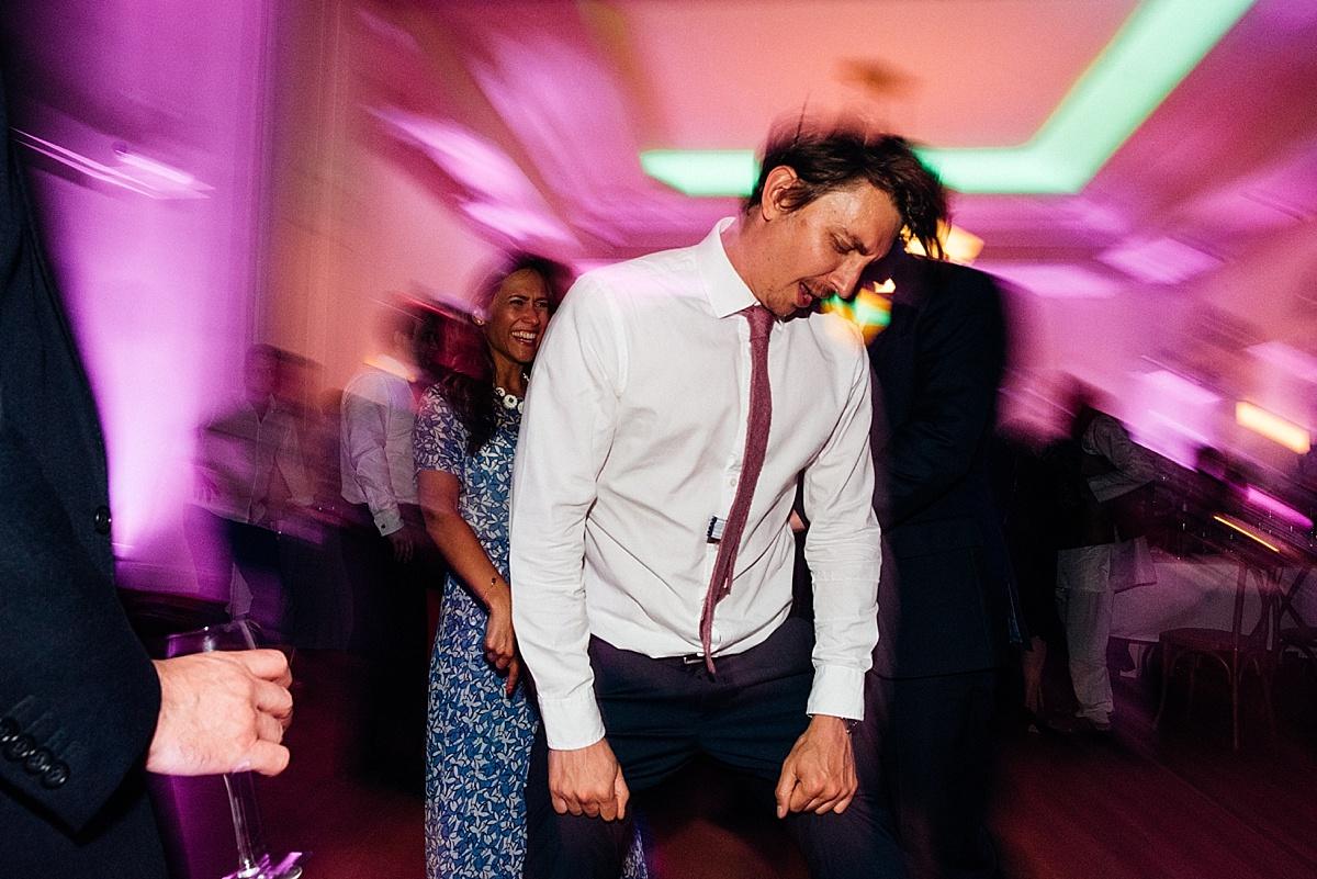 fun wedding party man headbanging wedding party