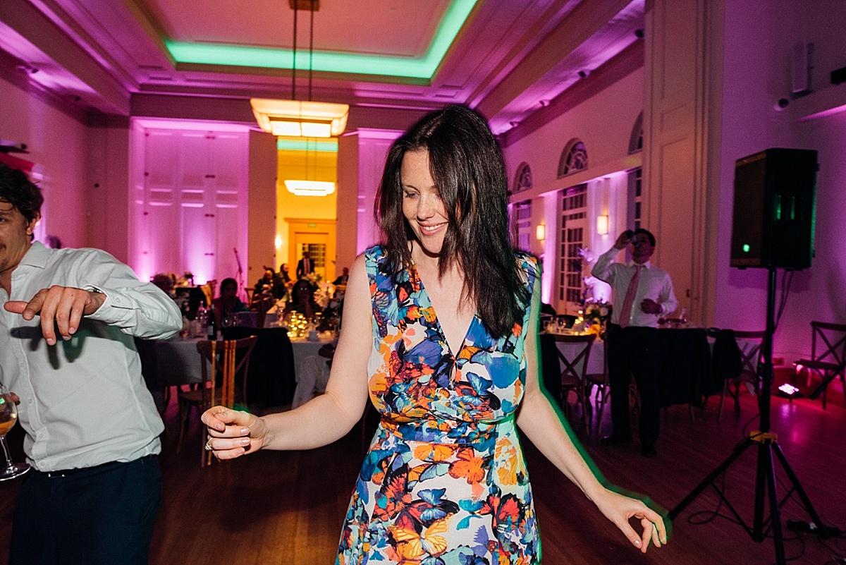 fun wedding party woman coloured dress dancing