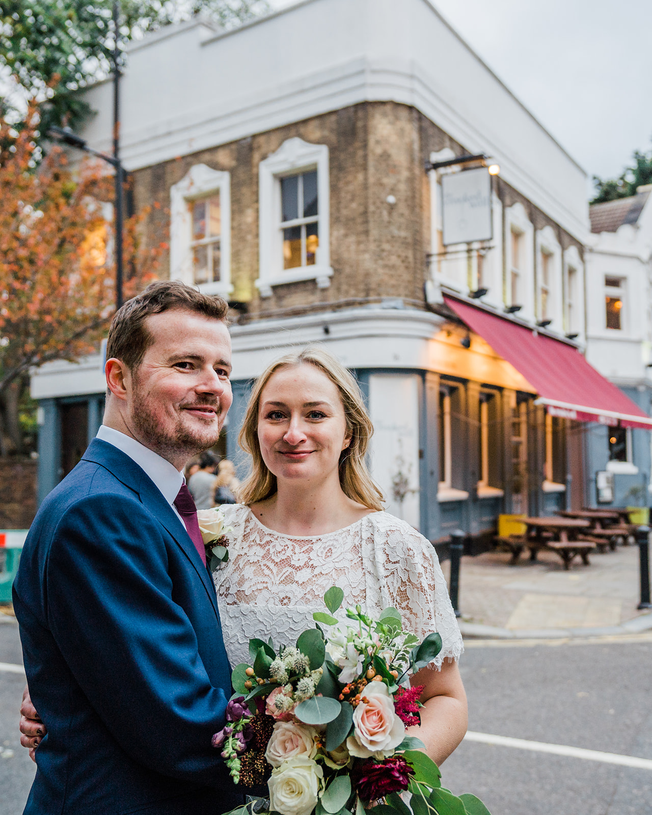 Bride and groom standing outside the Crooked Well Pub in South London | South London Pub Wedding | Photo by Parrot and Pineapple