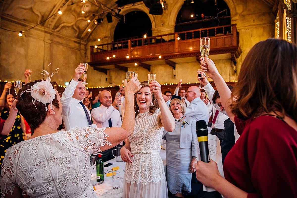 Battersea Arts Centre Wedding - couple and guests toast the wedding speech