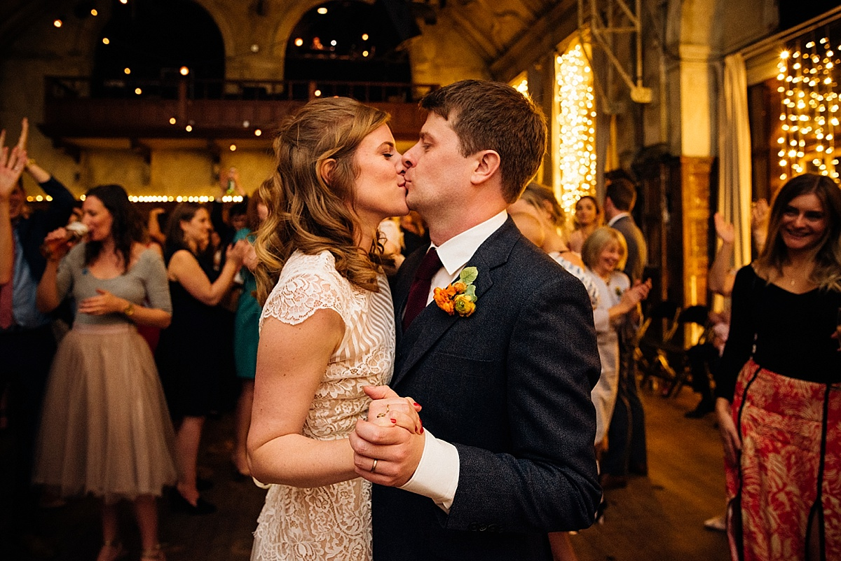 Bride and Groom kiss on the dance floor at wedding reception at battersea arts centre