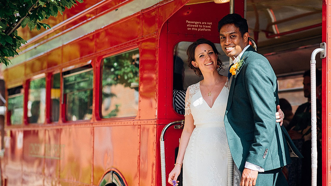 bride-and-groom-london-bus-cultural-fusion-parrot-and-pineapple