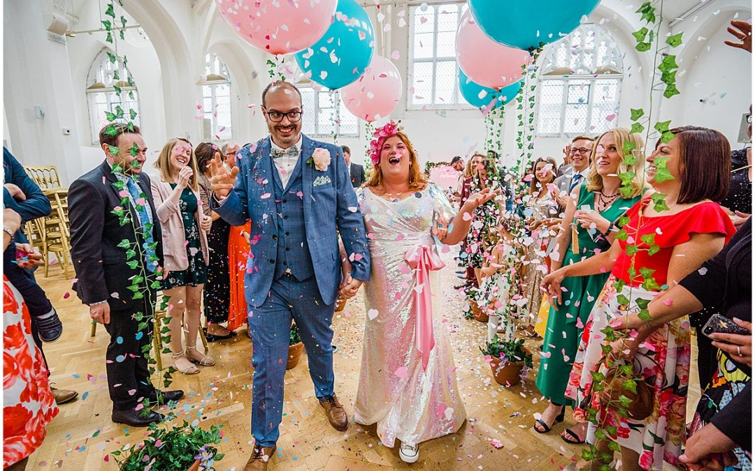 bride sequin wedding dress and groom walk through confetti at Tghe Old Library Birmingham. Parrot and Pineapple.