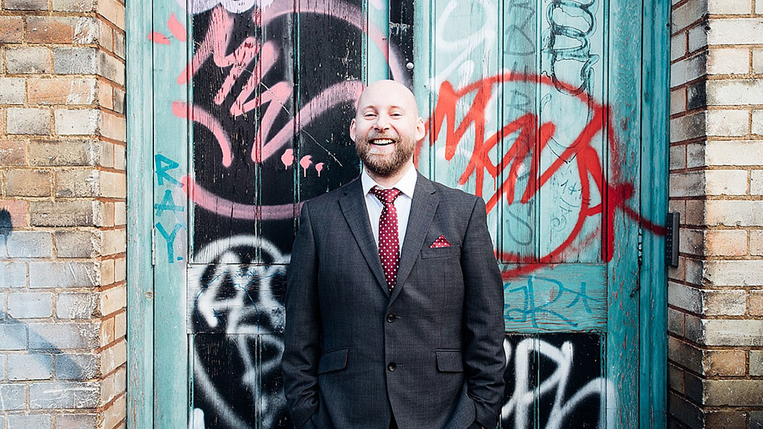 Groom in front of graffiti - London elopement wedding