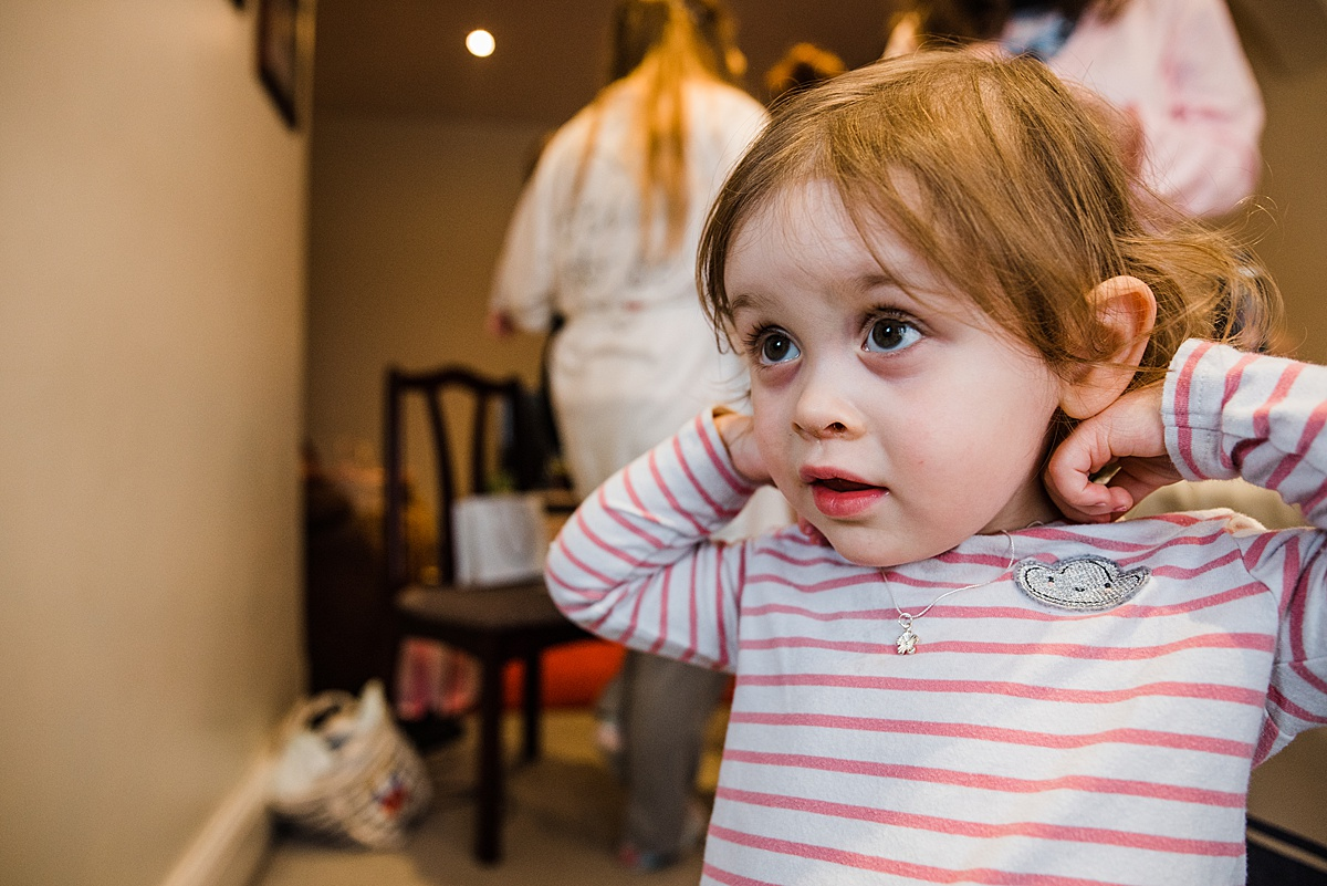 Kat's daughter trying on her necklace for the wedding - Photo taken by Parrot and Pineapple Wedding Photography