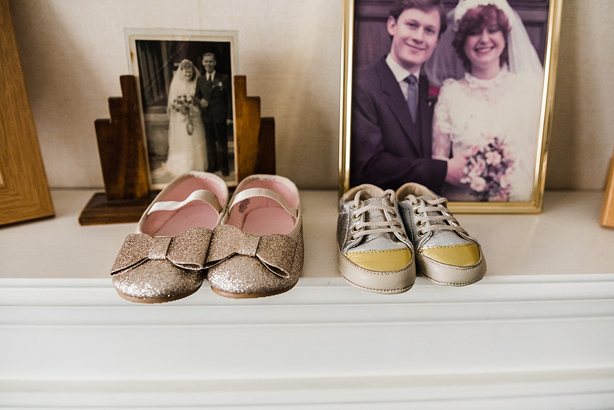 A pair of glittery pumps and trainers for Kat and Aaron's children's wedding shoes - Photo taken by Parrot and Pineapple Wedding Photography