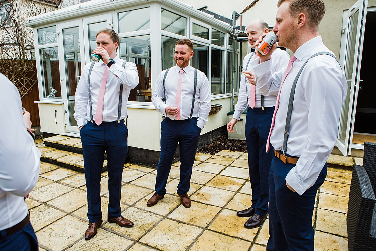 The Groomsmen chatting in the garden before the wedding - Photo taken by Parrot and Pineapple Wedding Photography