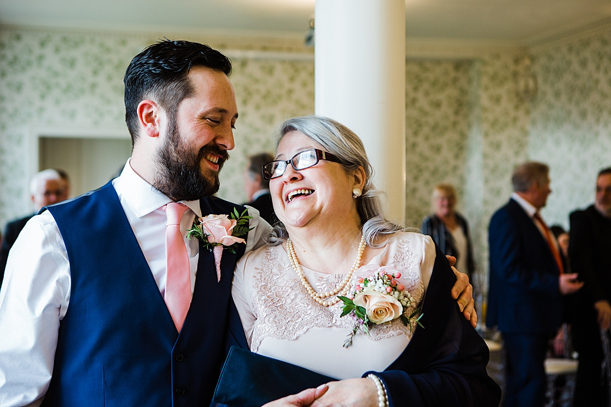 The Groom, Aaron and his mum sharing an embrace before the ceremony - Photo taken by Parrot and Pineapple Wedding Photography