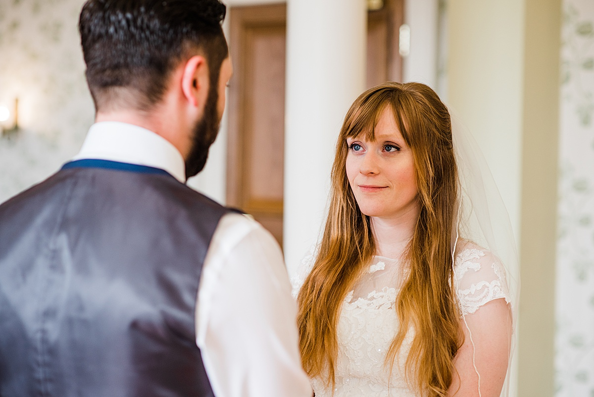 Close up of Kat and Aaron's faces during the ceremony - Photo taken by Parrot and Pineapple Wedding Photography
