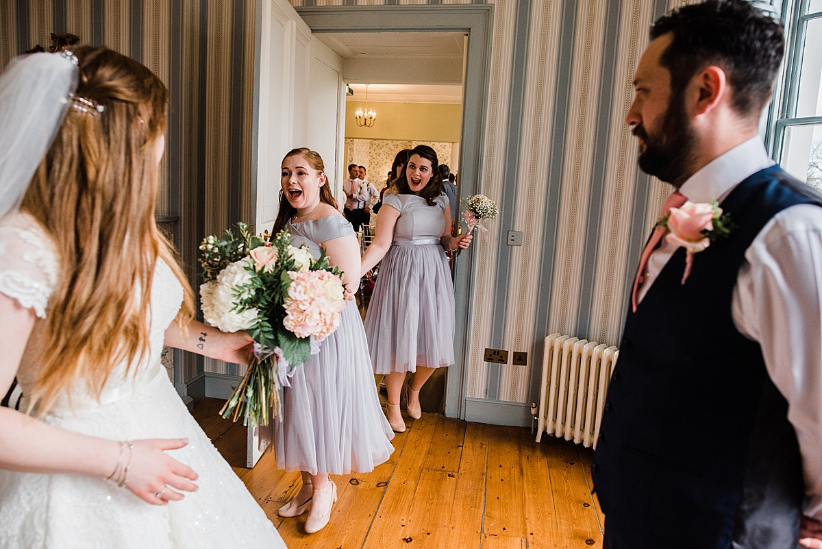 The bridesmaid enter the room after the ceremony cheering - Photo taken by Parrot and Pineapple Wedding Photography
