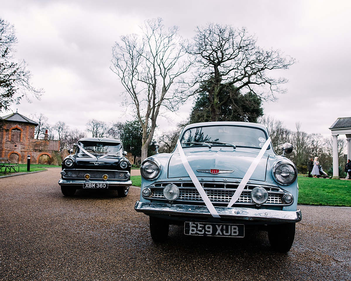 The vintage wedding cars parked outside the venue - Photo taken by Parrot and Pineapple Wedding Photography