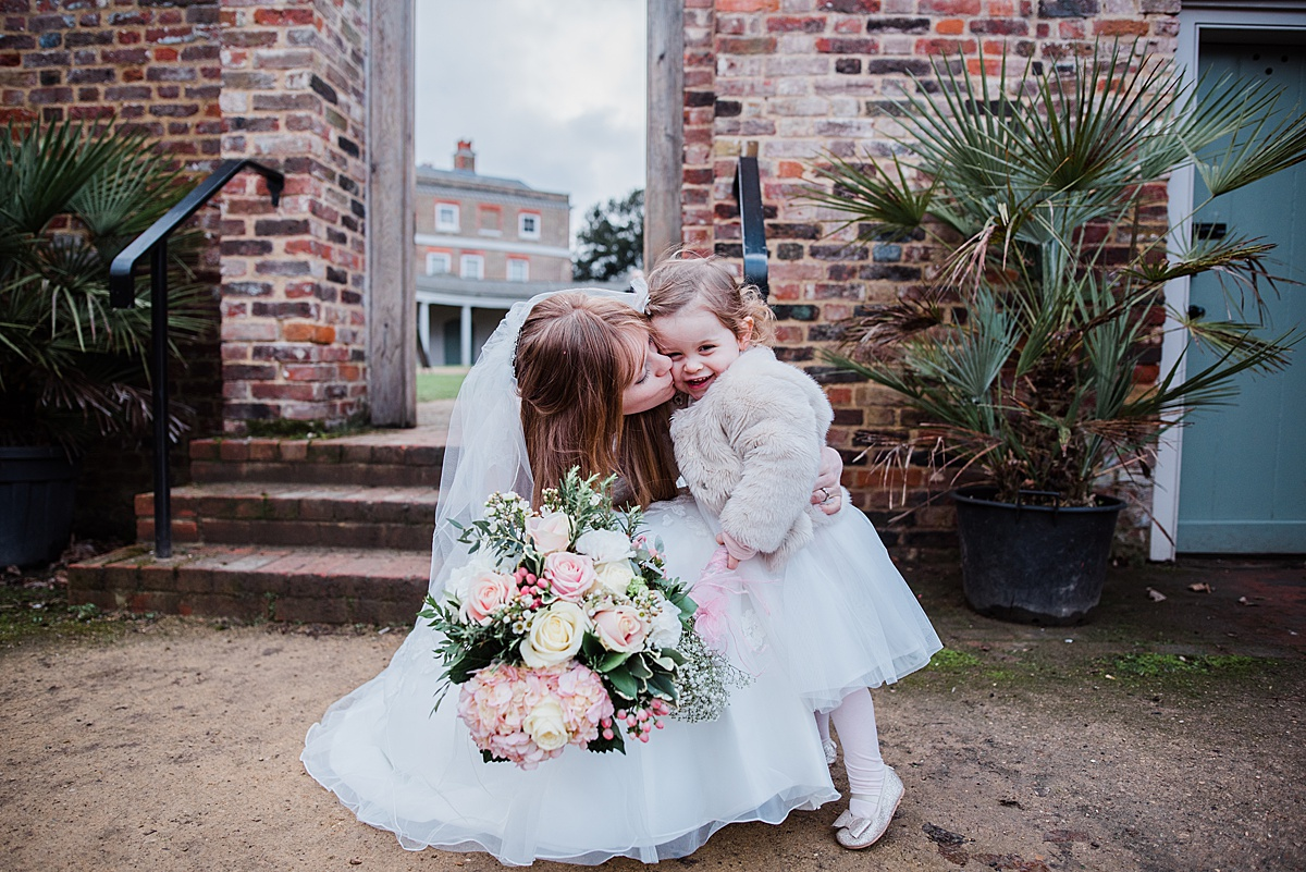 Kat having a cuddle and kiss with her daughter outside the wedding venue - Photo taken by Parrot and Pineapple Wedding Photography
