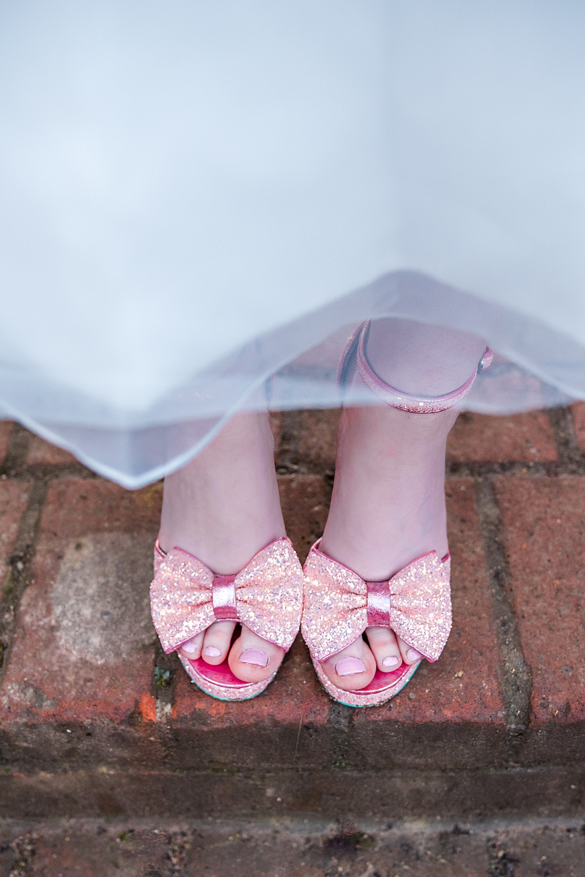 Close up of Kat's sparkly wedding vintage inspired peep toe shoes - Photo taken by Parrot and Pineapple Wedding Photography