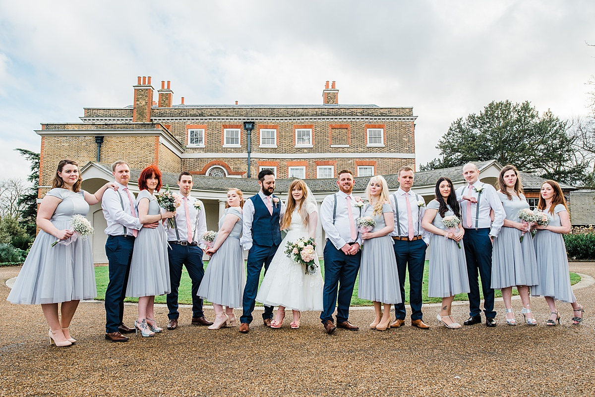 Beautiful Valentines Mansion Wedding with Bridal Party outside taken by Parrot and Pineapple Wedding Photography