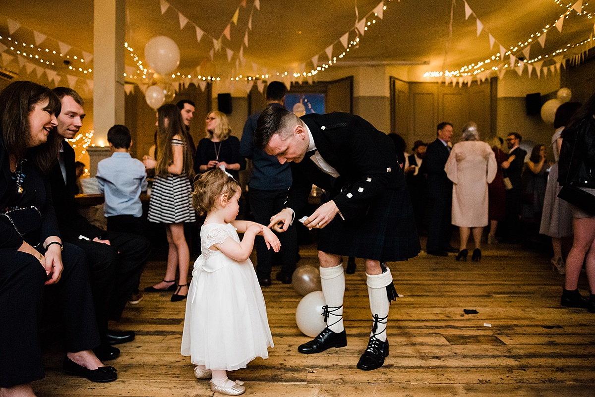 Wedding guest and bride and grooms daughter on the dance floor - Photo taken by Parrot and Pineapple Wedding Photography