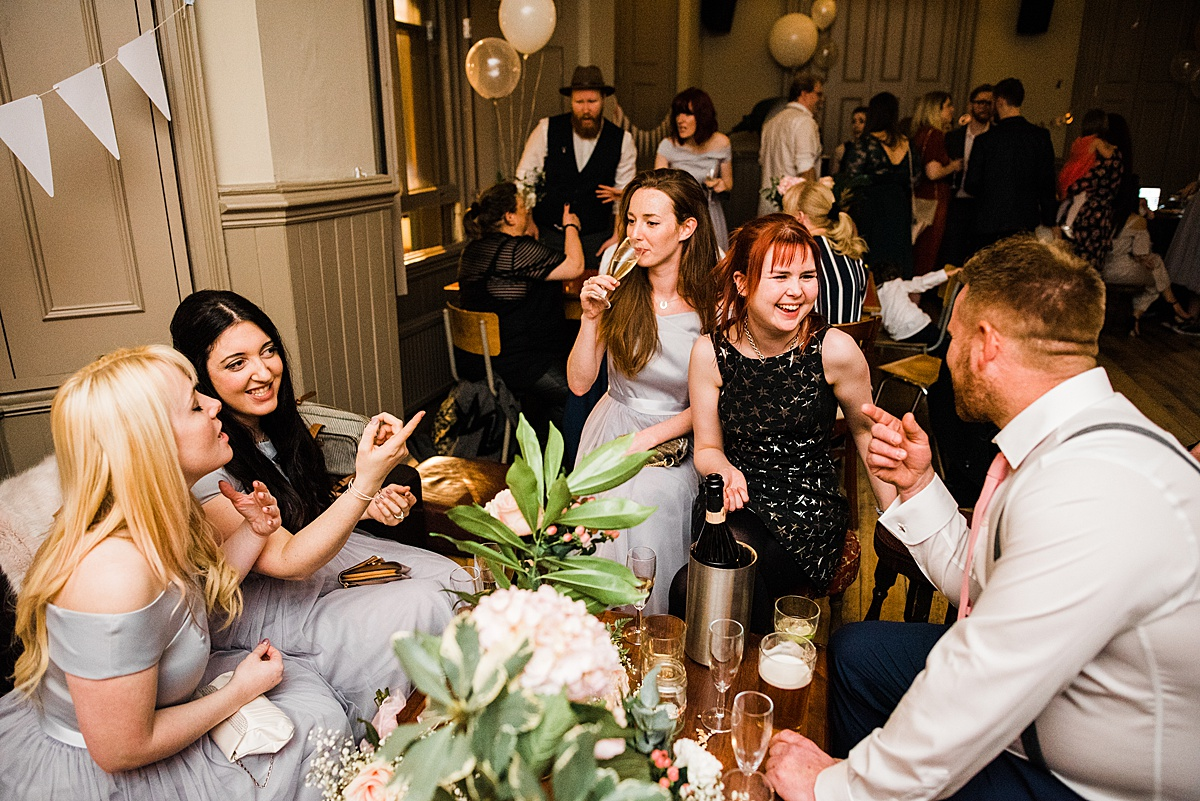 Wedding Guest chatting at reception, The Birds Pub Leytonstone - Photo taken by Parrot and Pineapple Wedding Photography