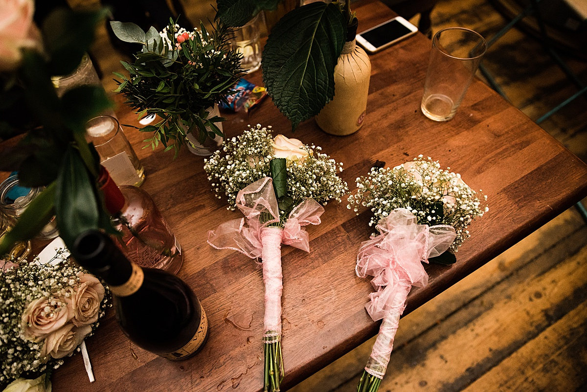 Wedding Bouquets on the table - Photo taken by Parrot and Pineapple Wedding Photography