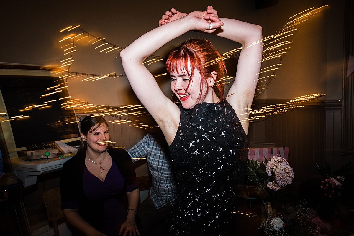Wedding guest pulling some shapes on the dance floor - Photo taken by Parrot and Pineapple Wedding Photography